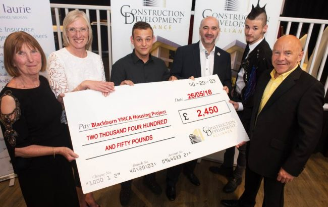 Construction and Development Alliance presents YMCA Blackburn with a cheque