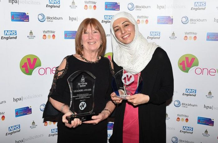 Chris Seddon and Ahlam Hasan with Awards